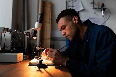 electrical engineer soldering pcb